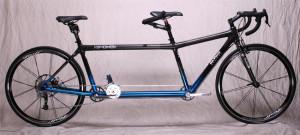 Custom carbon fiber tandem bike for taller rear rider.