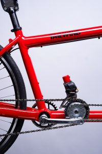 Closeup of red Tailwind electric assist tandem bicycle drive chain
