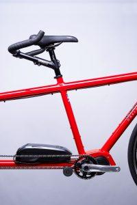 Closeup of red Tailwind electric assist tandem bike mid drive