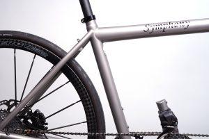 Closeup of titanium da Vinci Designs Symphony tandem bicycle with carbon fiber Spinergy wheels