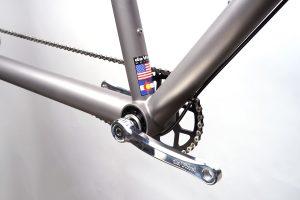 Closeup of da Vinci Designs Titanium tandem bike eccentric bottom bracket